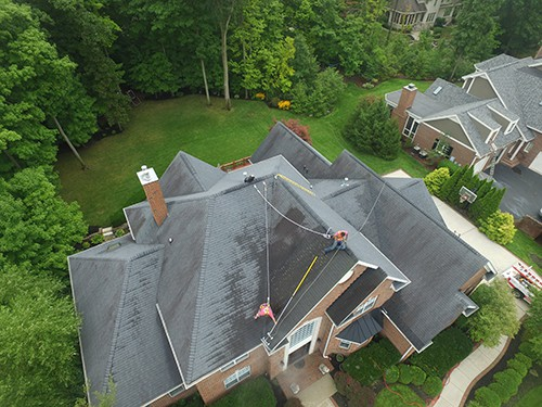 Black Algae Stains on roof before Green Eco Solutions roof replacement